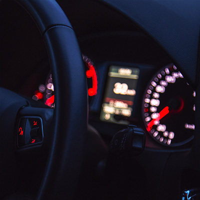 car steering wheel and dashboard lit up